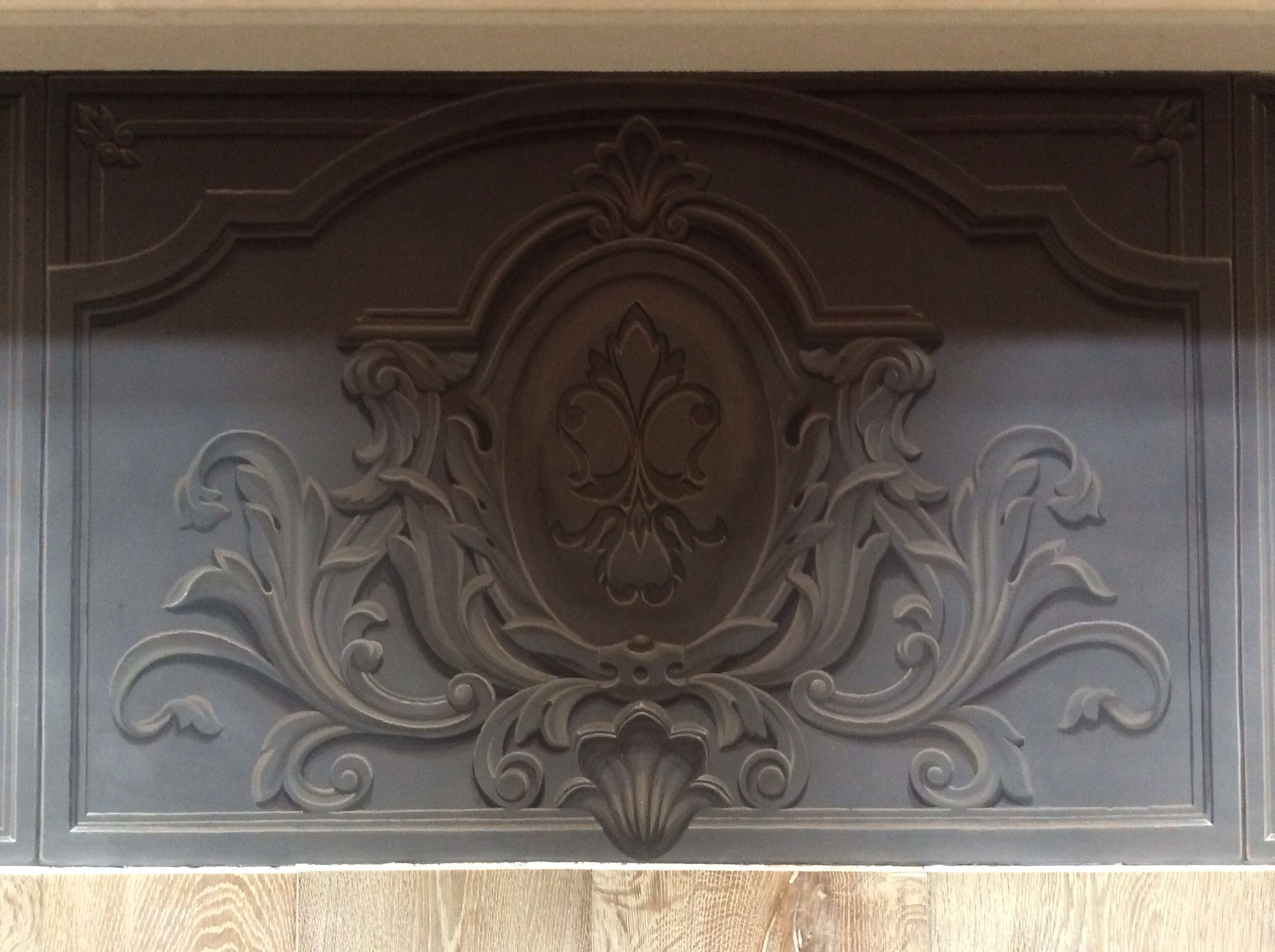 Painting on a floor round the fireplace, imitating cast iron ...