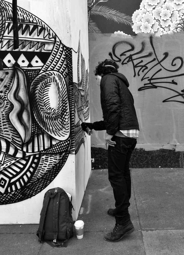 SF-based artist Zio Ziegler putting the finishing touches on a new mural at the corner of Divisadero and Grove, San Francisco (May 2013). via haighteration