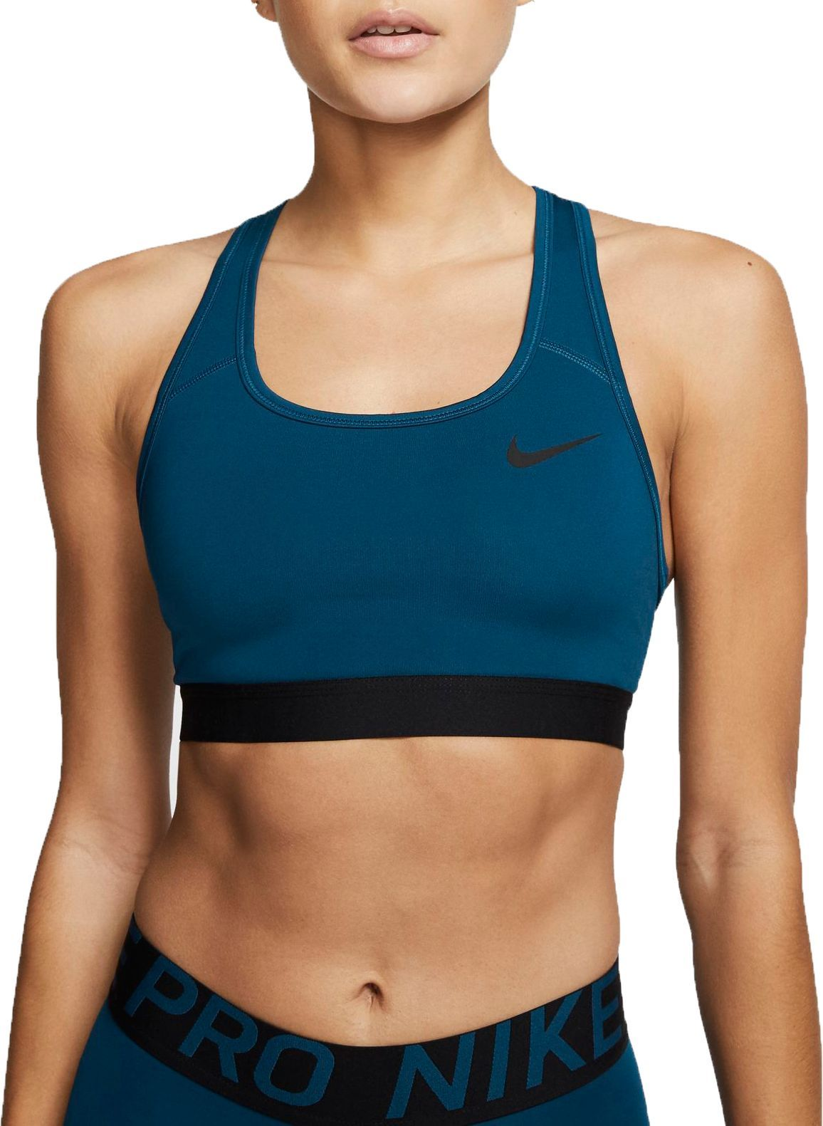 Fit Tight fit for a body-hugging feel Racerback design helps you move freely All-purpose compressive fit designed for all activities Technology Dri-FIT®: technology pulls sweat away from your skin to help you stay dry and comfortable Design Non-padded Nike Swoosh Sports Bra is made with compressive fabric for a supportive feel during medium-impact workouts Elastic underbust band