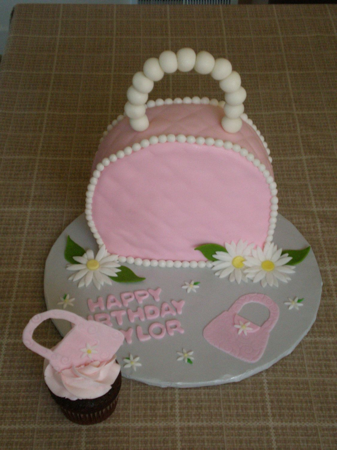 "- 8"" round w/ bottom cut off a little. Cupcakes to match. Little purses mafe from fondant and dried.  The little girl loved it!"