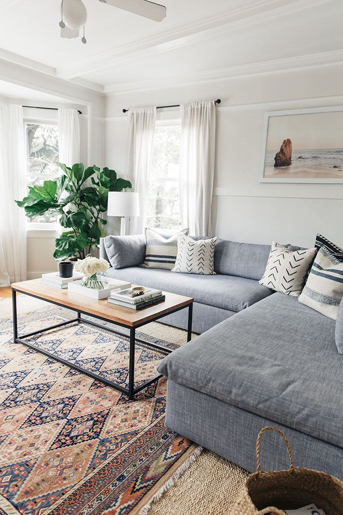 Living Room | White Living Room | Gray Couch | White Curtains | Vintage Rug  | Industrial Coffee Table | Fiddle Fig | Ocean Art