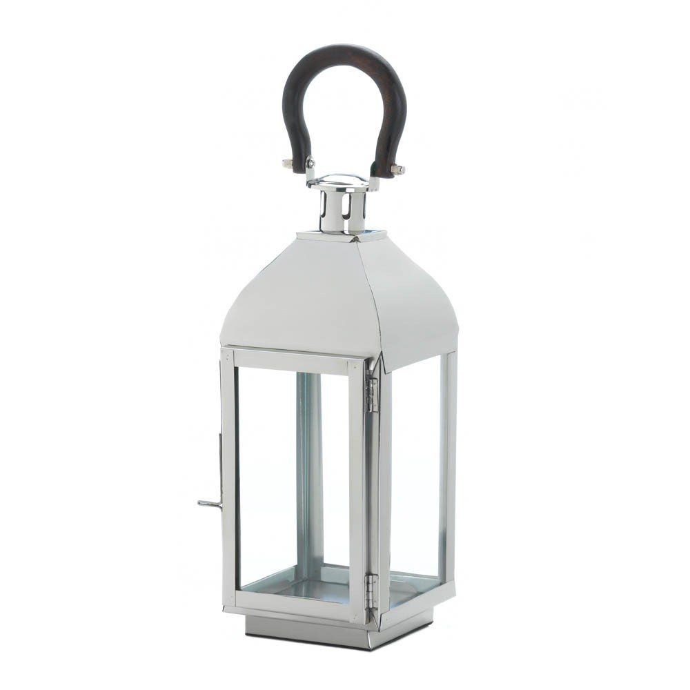 Tribeca Medium Candle Lantern - This medium-sized candle lantern is extra cool thanks to its contrasting black top loop. The sleek frame holds four clear glass panels that will let the light from your favorite candle shine bright.