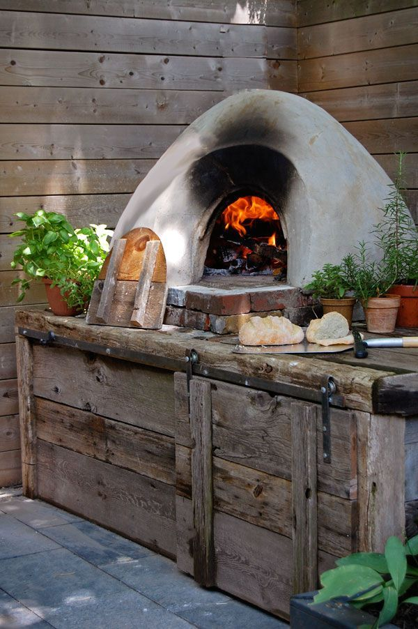 Cob Oven To Make Pizza, Bread, Roasts Or Pie. The Fire Goes Right
