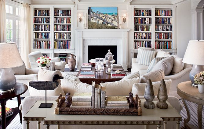Books in Great Room/U shaped variable seating around fireplace, console behind couch to divide room.
