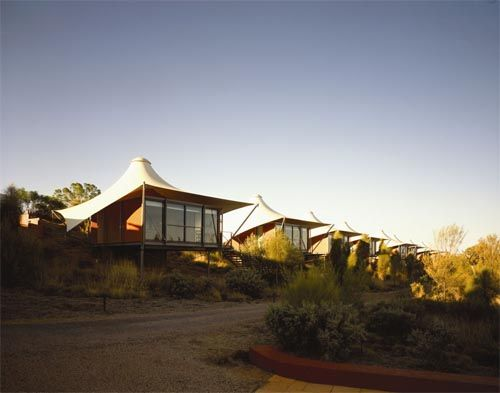 Tent House..... award-winning luxury wilderness camp in Australia's Red Center has achieved new heights in eco-tourism the world over. Longitude 131° is a deluxe camping experience like no other and set atop an isolated sand dune close to the border of the Uluru-Kata Tjuta National Park.