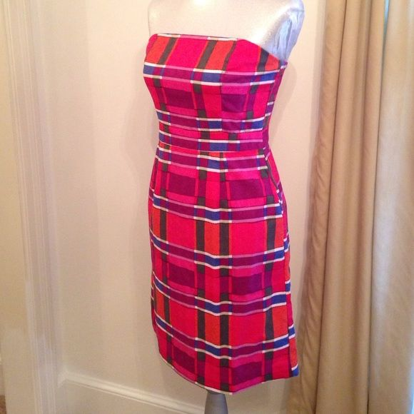 Banana Republic Sleeveless Dress Plaid Print SZ 2 Worn three times. Bright colors. No fading. Just washed and pressed. Marked size 2. Around the chest measures 32 1/2 inches. Underarm to hem is 28 inches. Waist laying flat and measuring from front 13 1/2 inches. Hips 18 1/2 inches with dress laying flat. Dress has pockets. No spots or damage. Banana Republic Dresses