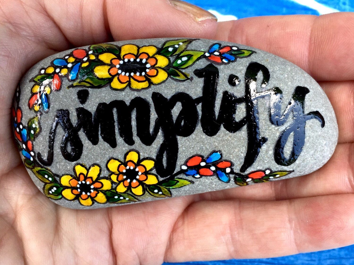 A personal favorite from my Etsy shop https://www.etsy.com/listing/462175266/simplify-painted-stones-painted-rocks