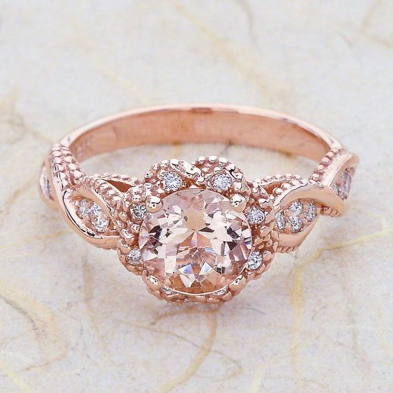 Elegant Ladies K Vintage rose gold engagement ring The center is a MM Round cut