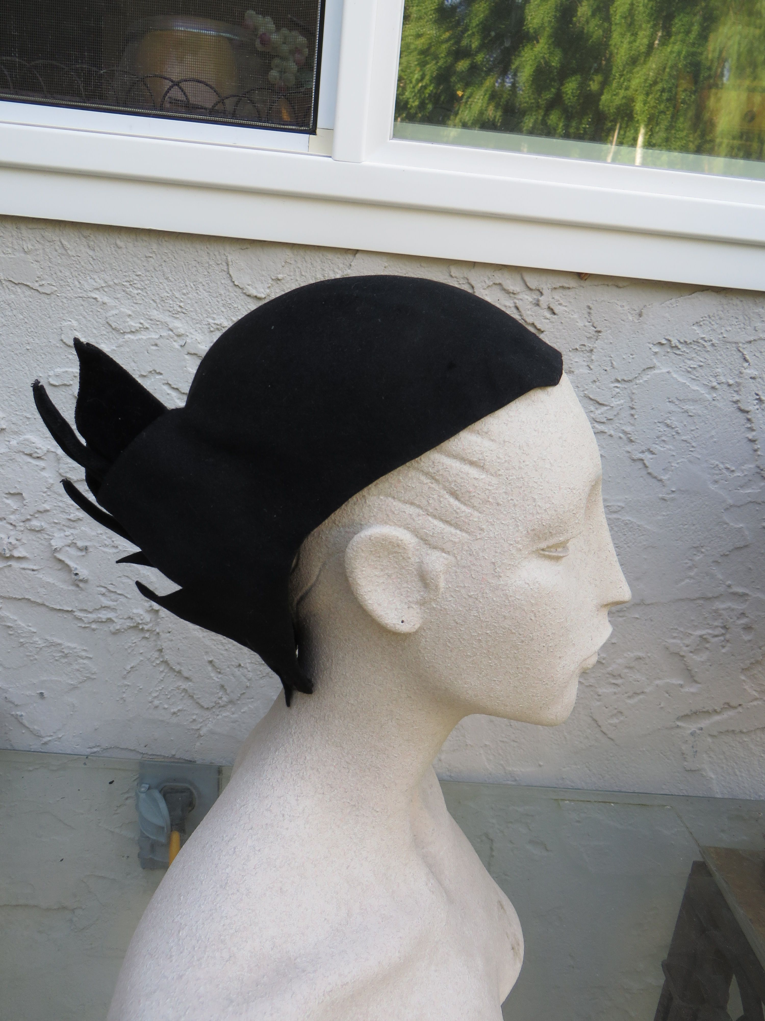 Armani Hat. New find. Tring to get info on it. Looks to be made of felt or wool. Any info would be appreciated. Could be a runway piece. Label say Giorgio Armani Made in Italy
