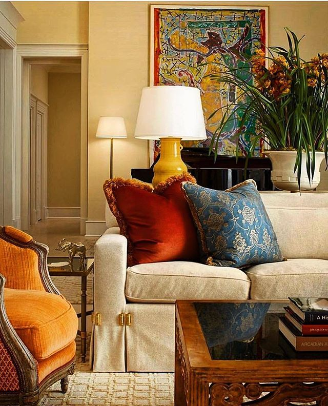 Cream Toned Living Room With Vibrant Details Such As The