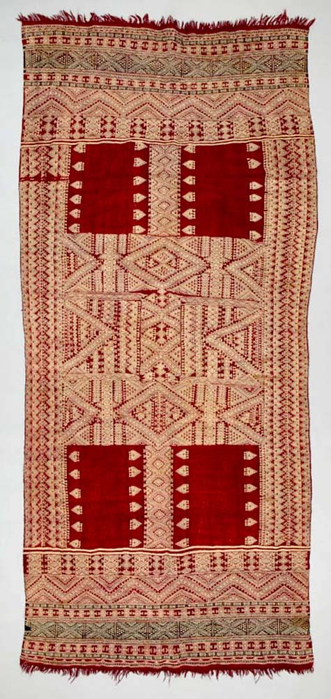 Africa - Shawl ~ bakhnug ~ from the Berber people living in Matmata, Gabès governorate, Tunisia, early to mid 20th c. Wool and cotton. Shawls of this type are woven, then dyed; the woollen ground accepts the dye, while the cotton supplementary weft remains white.