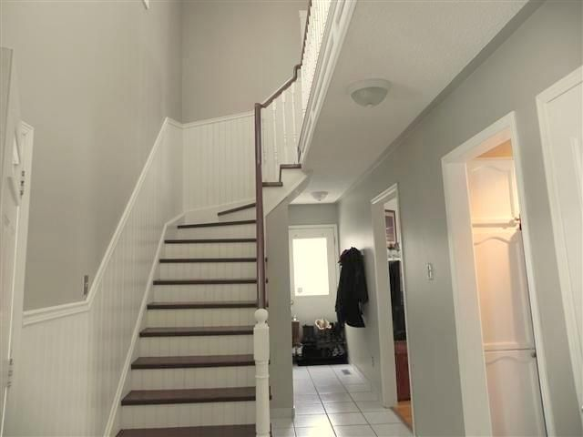 Grey Hallway With White Brown Staircase And Paneling Benjamin Moore S Cc490 Stone Hearth