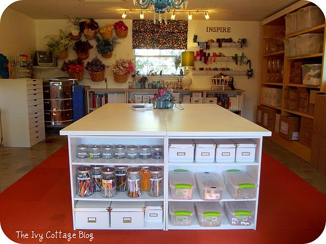 Large work table - two hollow core doors ($25 ea.), 4 Walmart book cases ($16 ea.)  Very smart!  SEWING/CRAFT TABLE!
