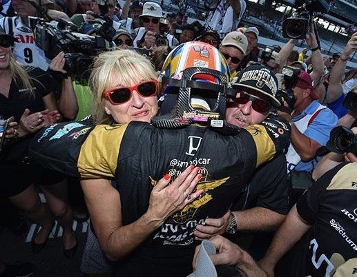 James Hinchcliffe hugs his parents after winning the pole for the 100th running of the Indy500