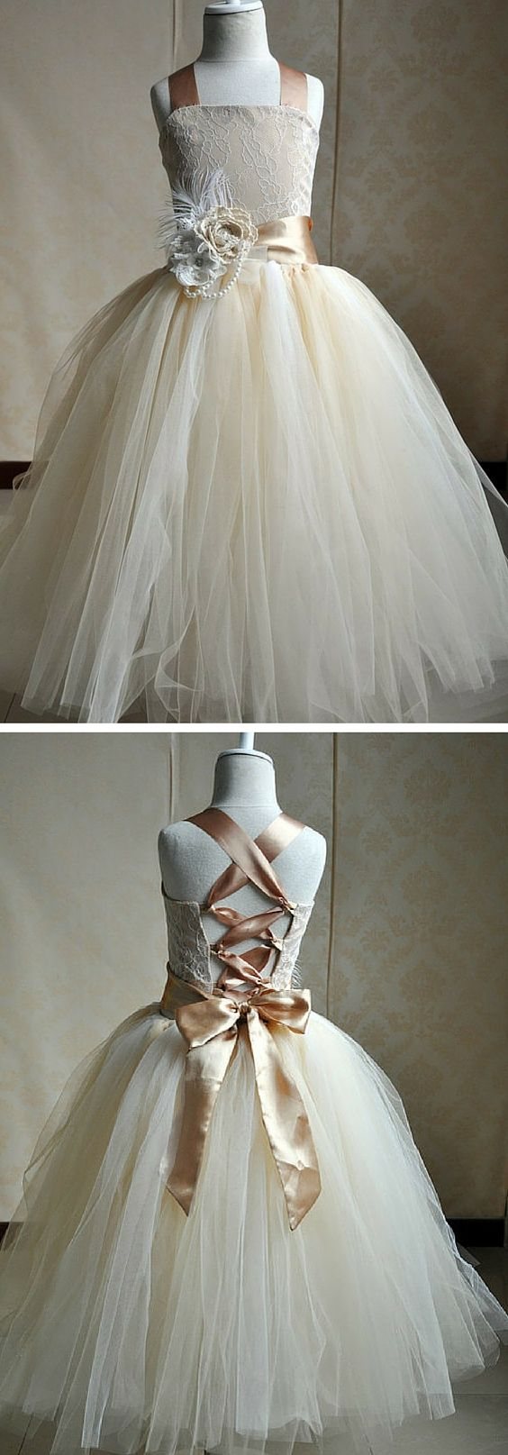 Champagne silk and tulle flower girl dress. This dress is a customer favorite and has amazing reviews! Your flower girl will feel so beautiful at your wedding.