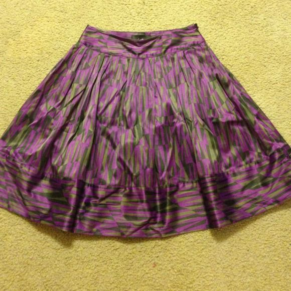 Beautiful Printed Purple, grey, and black skirt This skirt is made for a night out! Feels good to the touch and oh so comfortable! It is not meant to be worn very short. However, the size can also fit a small Forever 21 Skirts A-Line or Full