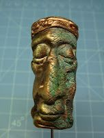 Polymer clay face bead, by SILASTONES,, WOW, looks just like copperish, maybe time to look at P. clays