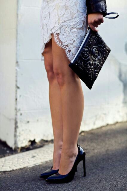 White lace skirt/black clutch.