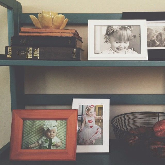 Holiday Tradition - Frame a Halloween photo each year and bring them all out to display in the fall. such a cute idea!