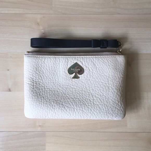 Nude Kate Spade Wristlet Brand new without tag Kate Spade Cobblestone Park Bee Wristlet in Nude/Black. Originally $78. I just got this and didn't even carry it out before I got another KS wristlet in similar color so this one is neglected. Otherwise it's completely perfect condition kate spade Bags Clutches & Wristlets