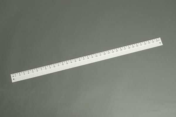 Braille-Large Print Yardstick  This yardstick is made of durable white plastic and is drilled for hanging. It has raised-line markings along one edge in 1/4 inch increments, with braille markings every 1 inch. Black large print markings are along the opposite edge in 1/4 inch increments.
