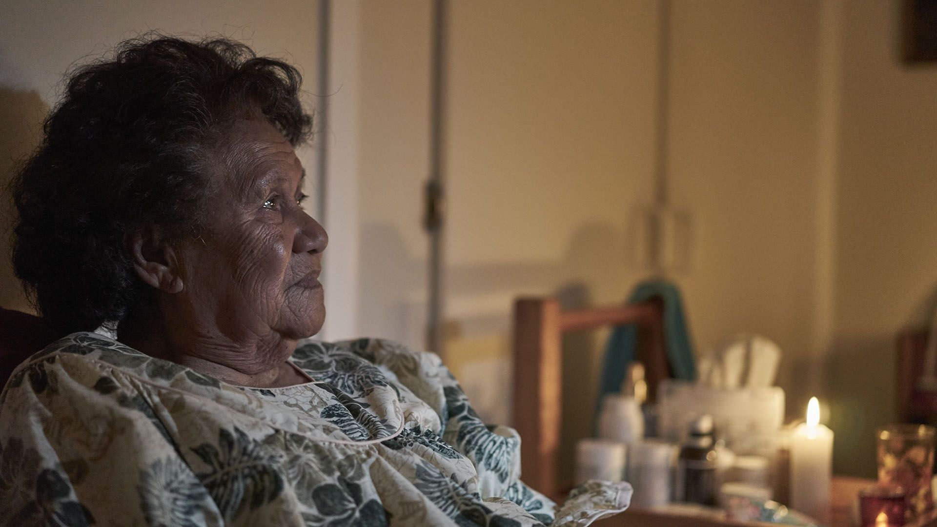 The matriarch of a large Polynesian family lies bedridden