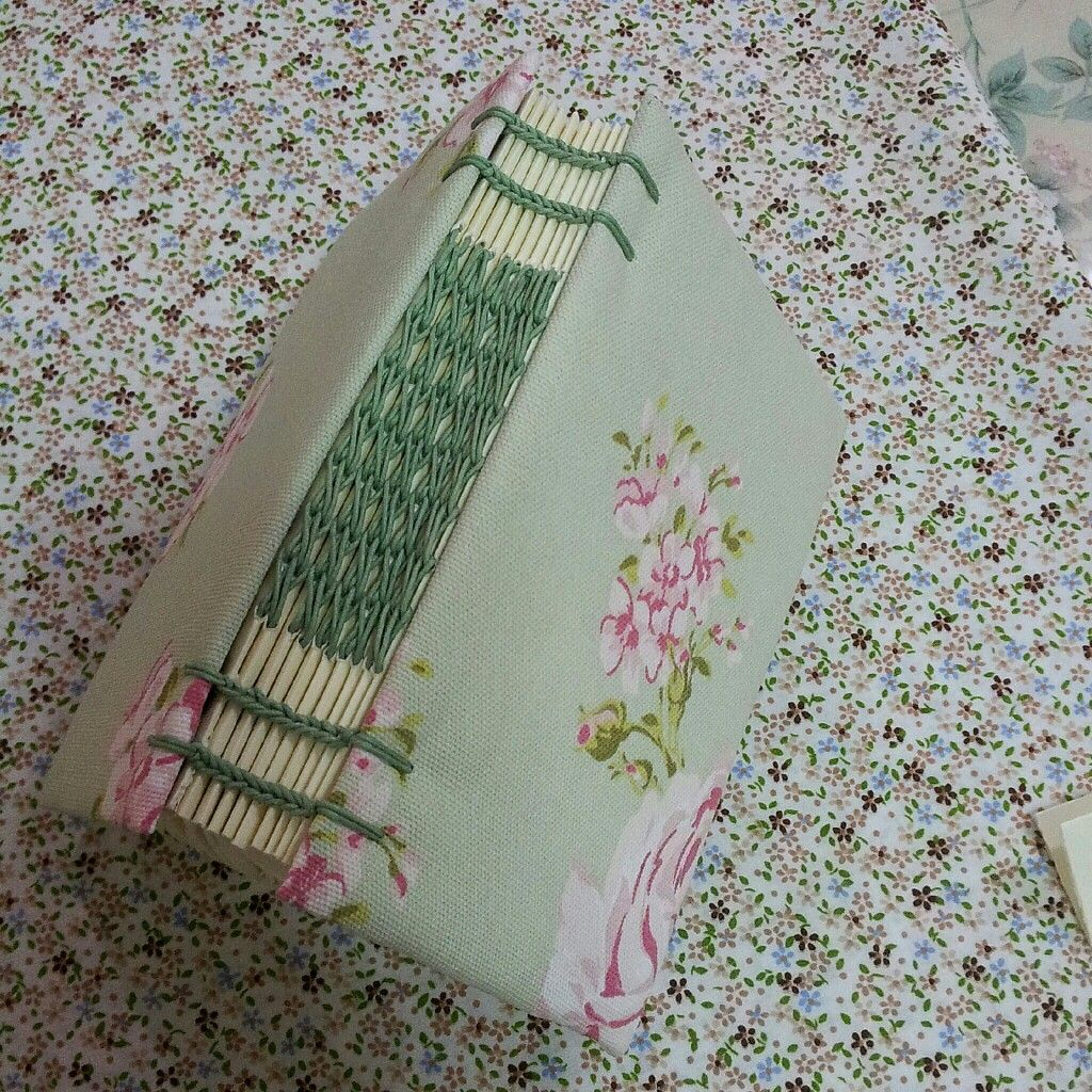 intricate exposed spine bookbinding - by craftsworker on Instagram.