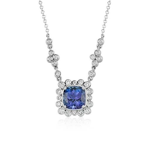 The brilliance of color is captured in this tanzanite and diamond necklace featuring a cushion shape tanzanite gemstones framed by round diamonds in 18k white gold.