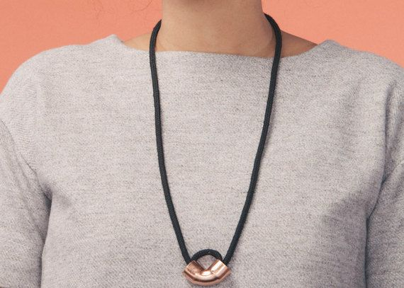 Long necklace with black rope and 90 degree copper piece. Simple and minimalist design. Model Jeanne
