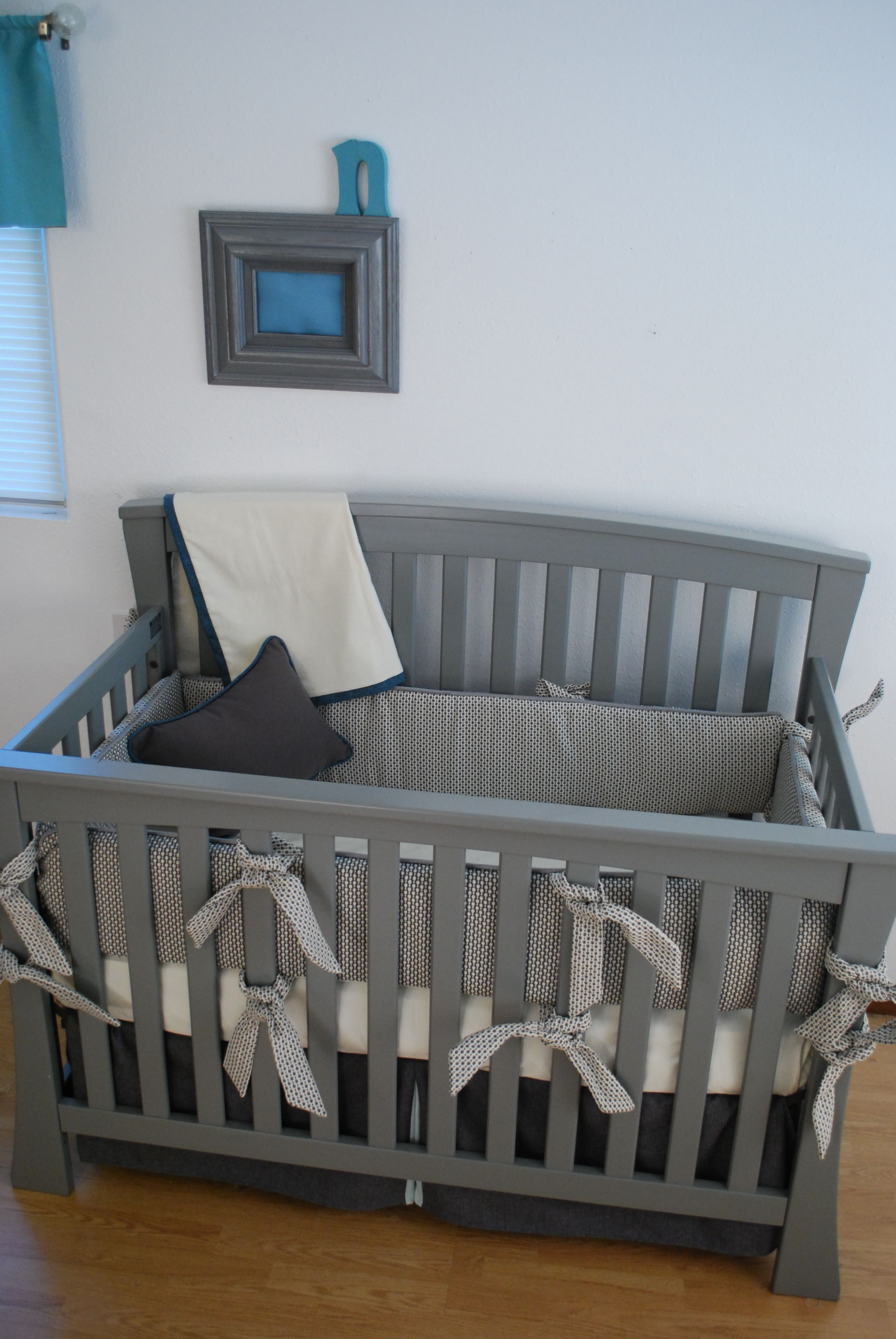 Charcoal Grey Crib Bedding With White And Aqua Fabrics In The Custom Nursery