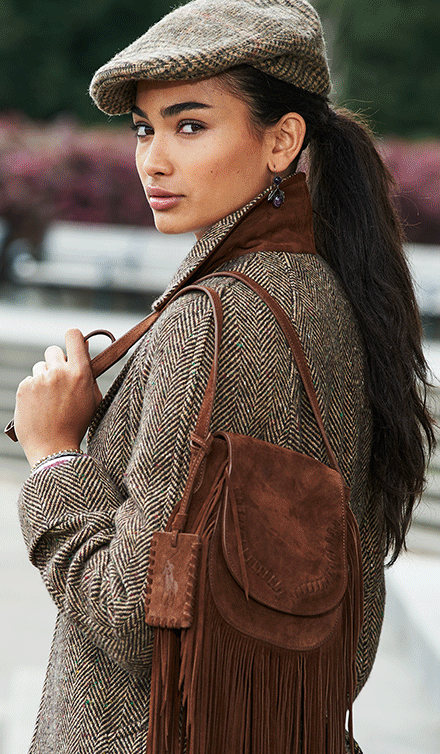 Update your look for fall with a mix of classic tweed and sumptuous brown  suede  the fringe saddle bag from Polo Ralph Lauren can be worn on the  shoulder or ... 9e05c38ac5cd5