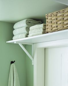 Need some extra storage in the smallest rooms of your home?  Try adding a simple shelf above the door to hide away towels and toilet rolls