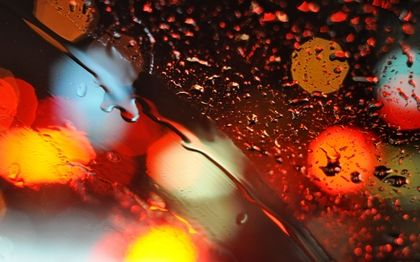 Colorful Rainy Lights Bokeh On Car Glass