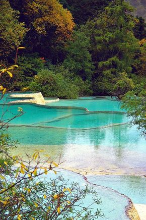 Huanglong Pools in Jiuzhaigou Valley, Sichuan, China (by lacitadelle).
