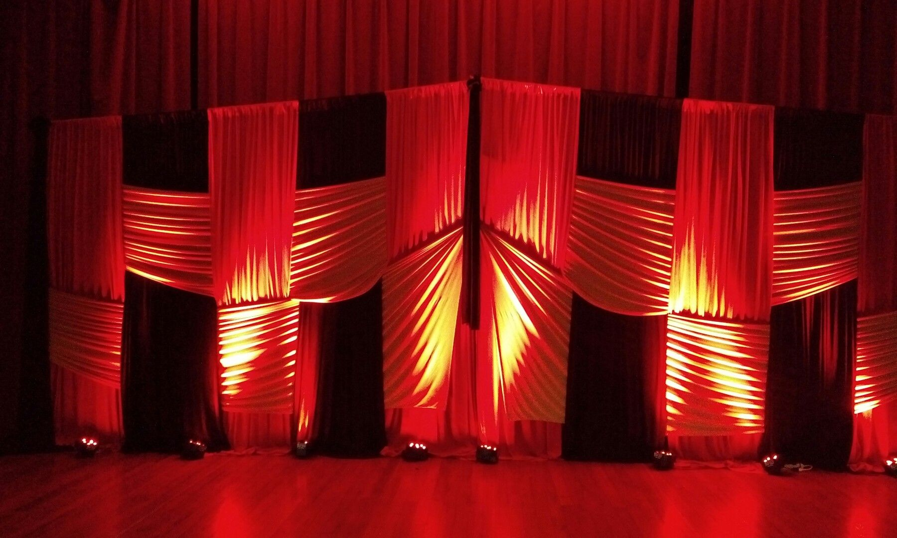 Red Black Gold Interwoven Backdrop For That Concert Event