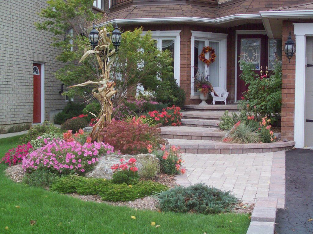 Stepped landscape birk 39 s landscaping design and build for Front window landscaping ideas
