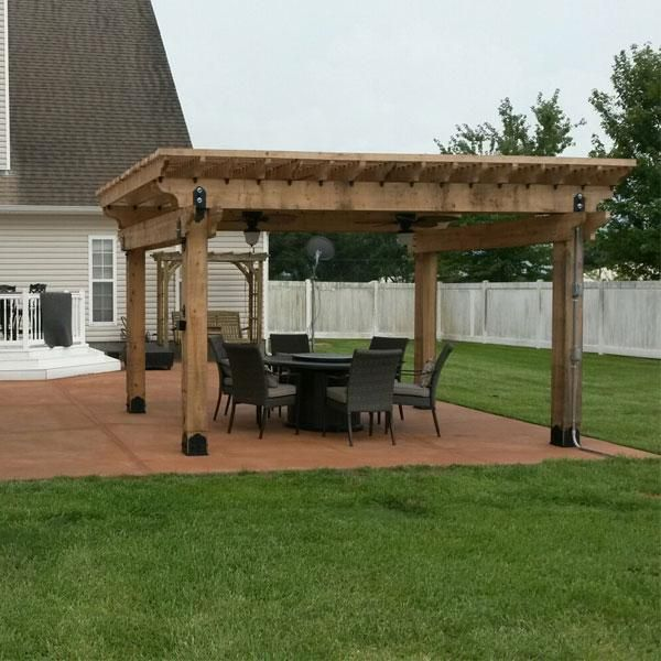 Patio Pergola featuring the Post Base Kit, Post to Beam Bracket Kit, and  Rafter Clips by OZCO Ornamental Wood Ties - Patio Pergola Featuring The Post Base Kit, Post To Beam Bracket Kit