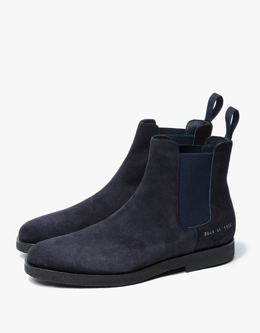 In an exclusive collaboration between Need Supply Co. and Common Projects,  a Chelsea boot in Navy. Elasticized side panels. Heel pull tab.