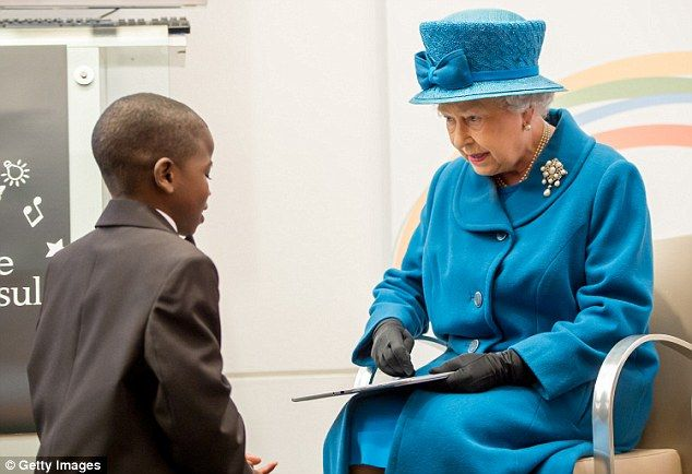 Above, the tech-savvy Queen is presented with a tablet by a young boy in 2012...