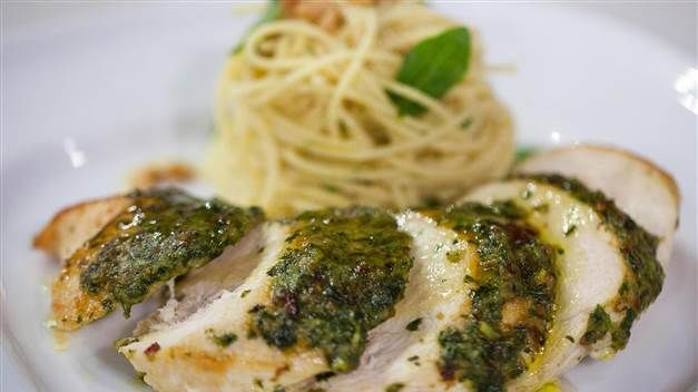 Pesto gets toasty in the oven and mingles with the juices from chicken in spaghetti to make this simple but satisfying weeknight dish.