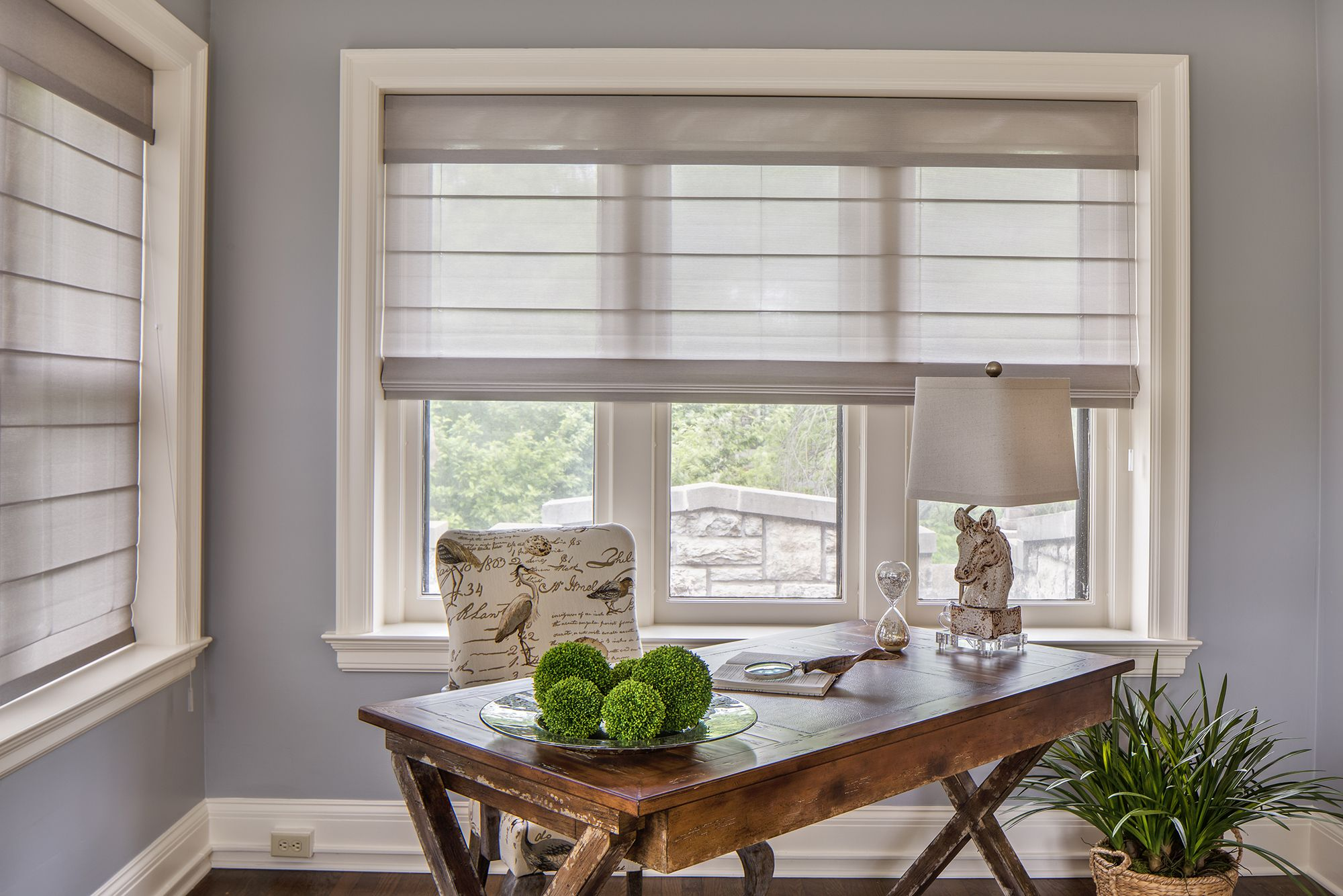 A Home Office With The Chic Light Filtering Charm Of Alustra Woven Textures Roman Shades In The 45th Symphony Ka Window Treatments Bay Window Treatments Home