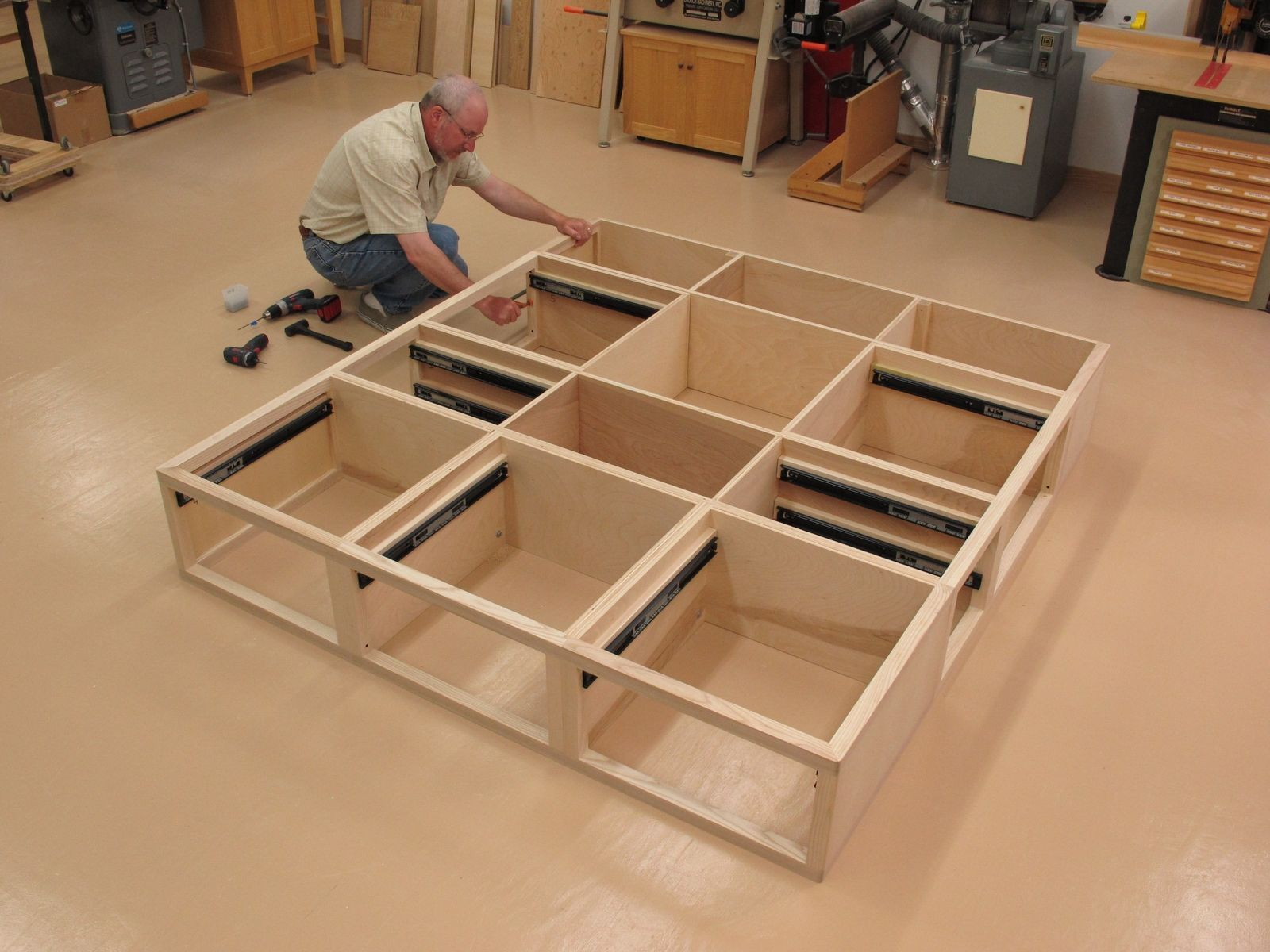 Custom ash kingsize storage bed with 9 drawers matching