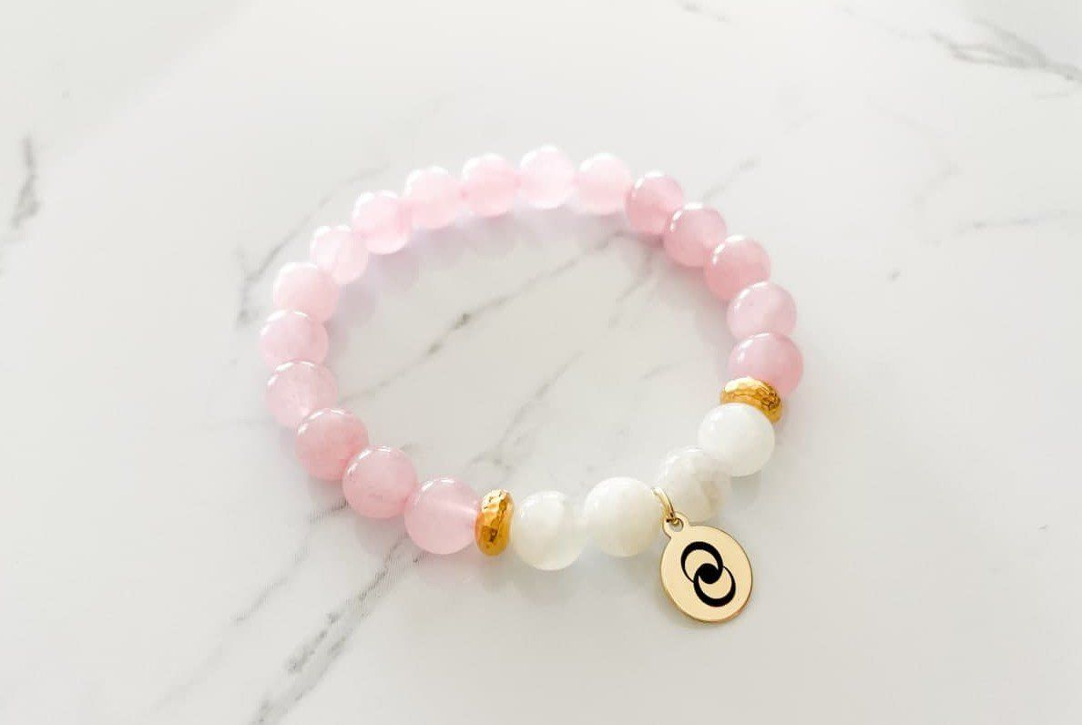 Wear this beautiful love & relationship bracelet to attract love into your life. Let go of self-judgement. Practice forgiveness and compassion. Love yourself and others unconditionally. You have the power to attract harmonious relationships into your life. Affirmation: I happily give and receive love each day. I have the power to attract love and harmony into my life. Handcrafted in Arizona Stones Used: Rose Quartz, Moonstone.Bead Size: 8 mm natural gemstone beads. Spacer Beads: non-tarnish,