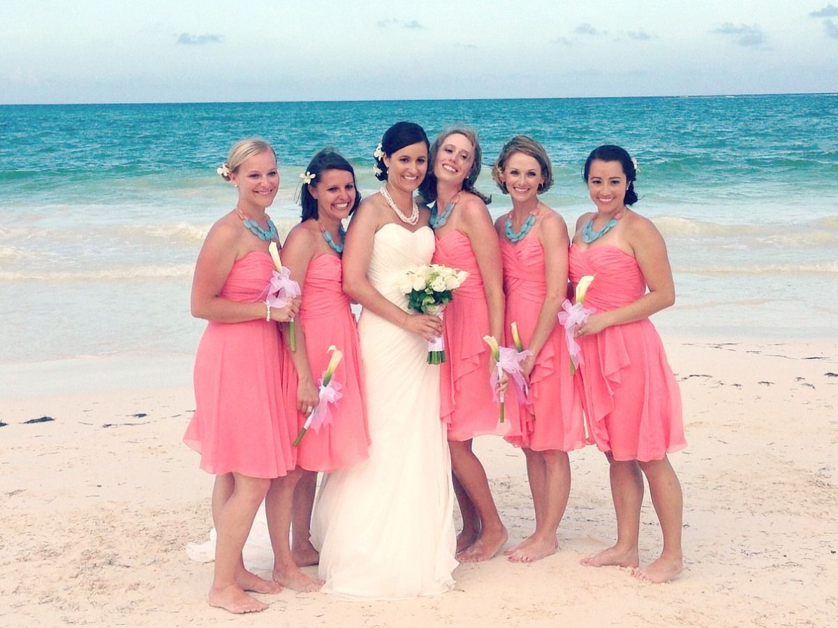 Bridesmaids in coral dresses with aqua necklaces {via ...