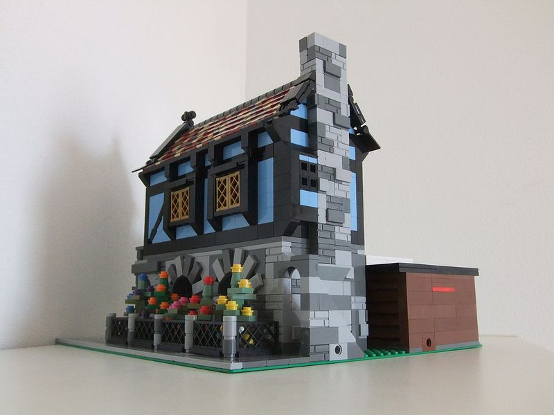 Lego Medieval House modular medieval corner house | the building attached to another