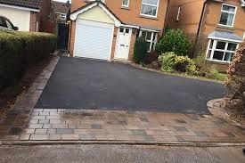 Image result for sloping tarmac driveway ideas uk no for Sloped driveway options