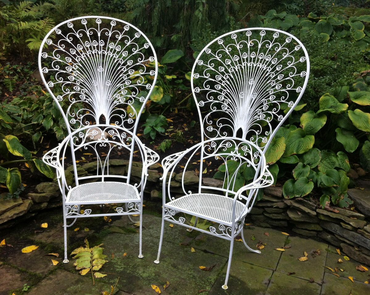The chairs were originally owned by Enid Haupt who was the benefactress of  the New York Botanical Garden. A rare pair of Salterini Peacock chairs  great original condition
