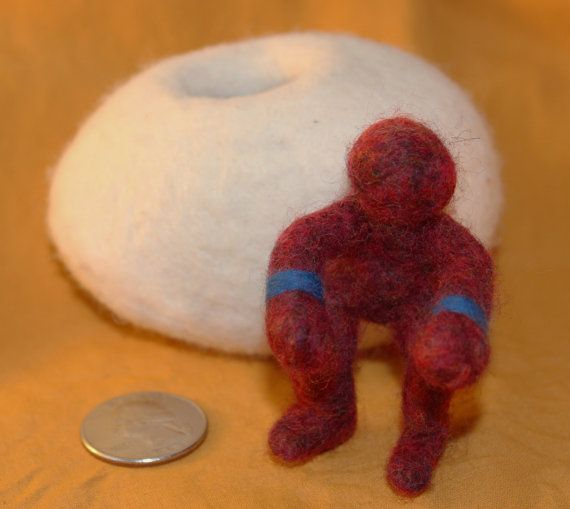White Felt Egg with Dark Red Figure by thefeltexperience on Etsy, $30.00