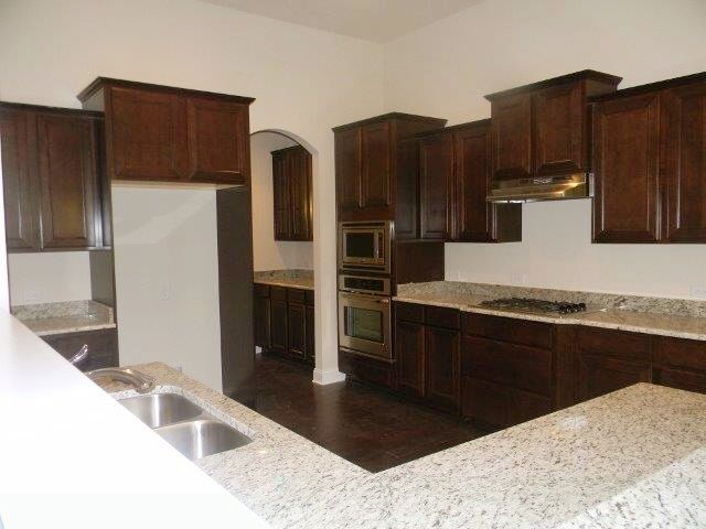 The Newberry Kitchen With Landen Maple Umber Cabinets Giallo Ornamental Granite Prefab Kitchen Cabinets Small Bathroom Remodel Cost Mahogany Kitchen