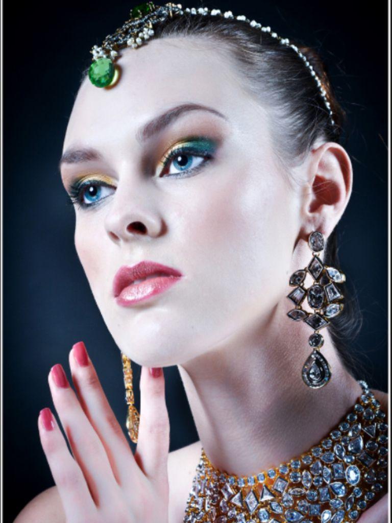 Beautiful makeup & wearing a Indian jewelry.